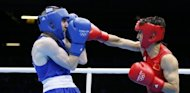 Zou Shiming of China (in red) defends against Paddy Barnes of Ireland (in blue) during the men&#39;s Light Flyweight (48kg) boxing semi-finals of the 2012 London Olympic Games. Zou won gold on August 10
