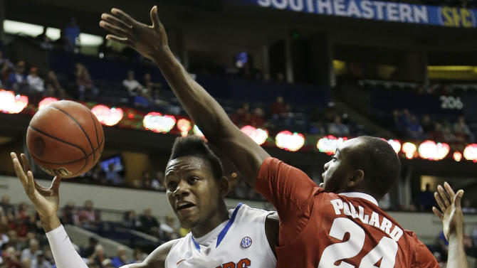 Florida forward Will Yeguete (15) works against Alabama forward Devonta Pollard (24) during the first half of an NCAA college basketball game in the semifinals of the Southeastern Conference tournament, Saturday, March 16, 2013, in Nashville, Tenn. (AP Photo/Dave Martin)