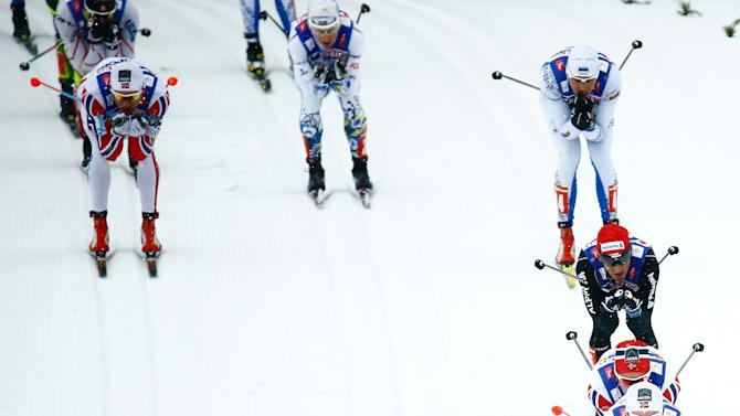 Athletes compete in the men's cross country 50 km mass start classic race at the Nordic World Ski Championships in Falun