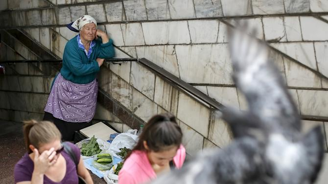 A street vendor waits for customers near an underground passage in central Kiev