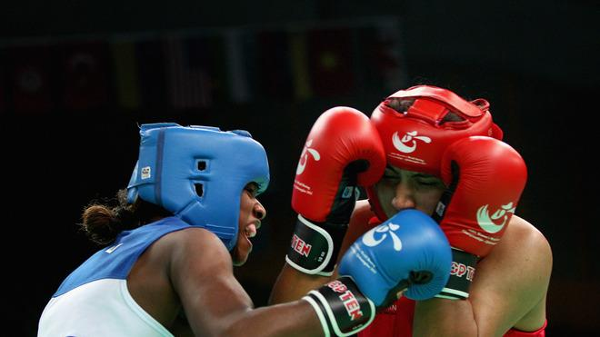 Claressa Shields (Blue) Of The United States Fights Against Pooja Rani (Red) Of India In The Women's 75kg Preliminary Getty Images