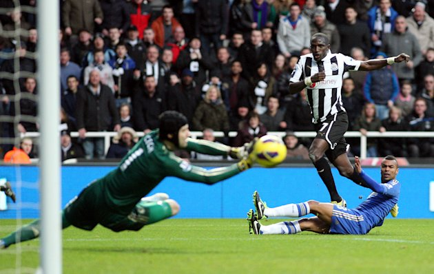 Newcastle United's Moussa Sissoko, center, has his shot saved by Chelsea's goalkeeper Petr Cech, left, during their English Premier League soccer match at St James' Park, Newcastle, England, Saturday,