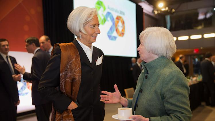 (IMF) shows IMF Managing Director Christine Lagarde, left, talking