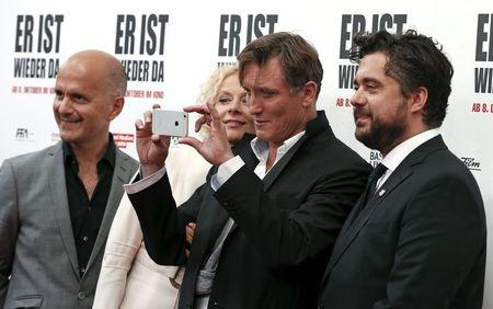 Actors Herbst, Riemann, Masucci and director Wnendt arrive on the red carpet at the world premier of the film 'Look Who's Back' in Berlin