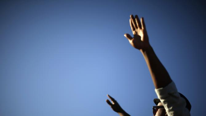A protester raises his arms during a march, following the Tuesday grand jury decision in the shooting of Michael Brown in Ferguson, Missouri, in Los Angeles, California