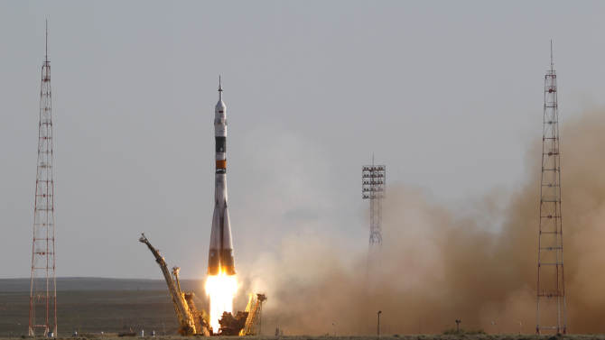 The Soyuz-FG rocket booster with a Soyuz TMA-04M spaceship carrying a new crew to the International Space Station, ISS, blasts off from the Russian leased Baikonur cosmodrome, in Kazakhstan, Tuesday, May 15, 2012. The Russian rocket is carrying U.S. astronaut Joseph Acaba, along with Russian cosmonauts Gennady Padalka and Sergei Revin. (AP Photo/Mikhail Metzel)