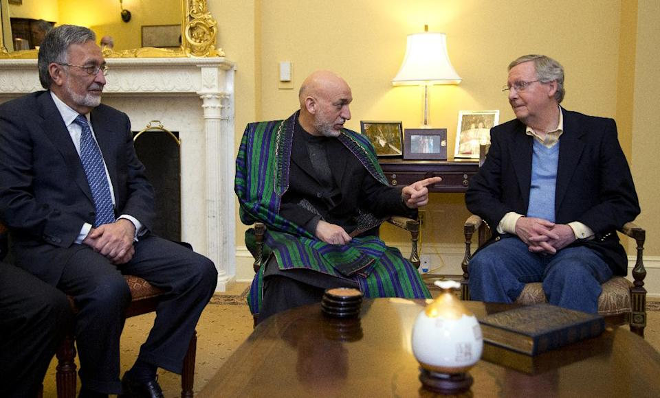 Afghanistan President Hamid Karzai, center, with his Foreign Minister Zalmay Rasul, left, meets Senate Republican Leader Sen. Mitch McConnell, R-Ky., on Capitol Hill in Washington, Wednesday, Jan. 9, 2013. (AP Photo/Manuel Balce Ceneta)