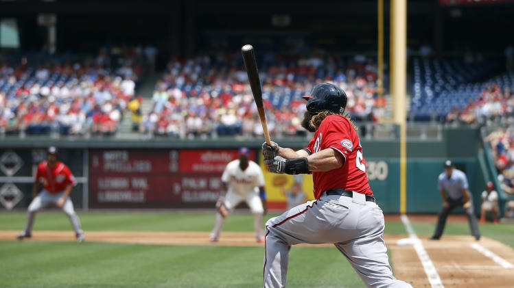 Washington Nationals' Jayson Werth follows through after hitting a three-run home run off Philadelphia Phillies starting pitcher Kyle Kendrick during the first inning of a baseball game, Sunday, July 13, 2014, in Philadelphia. (AP Photo/Matt Slocum)