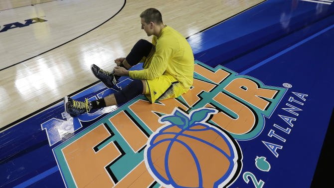 Michigan forward Mitch McGary (4) sits on the floor before the first half of the NCAA Final Four tournament college basketball championship game against the Louisville, Monday, April 8, 2013, in Atlanta. (AP Photo/David J. Phillip)