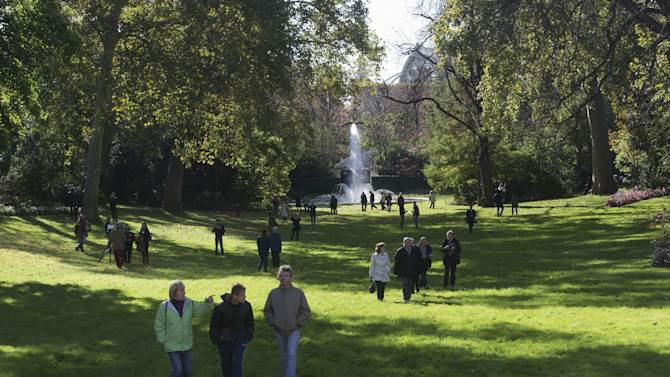 Parisians stroll in the presidential garden of the  Elysee Palace, Paris Sunday, Oct. 28, 2012. Visitors were taking advantage of a new policy inaugurated by President Francois Hollande to open the 18th-century Elysee Palace gardens to the public every last Sunday of the month. In the past, the palace and gardens were only open to the public once a year on France's Heritage Days weekend in September. The gardens are open from noon to 5 p.m. the last Sunday of the month from October to March, and from 1 p.m. to 7 p.m. from April to September. (AP Photo/Michel Euler)