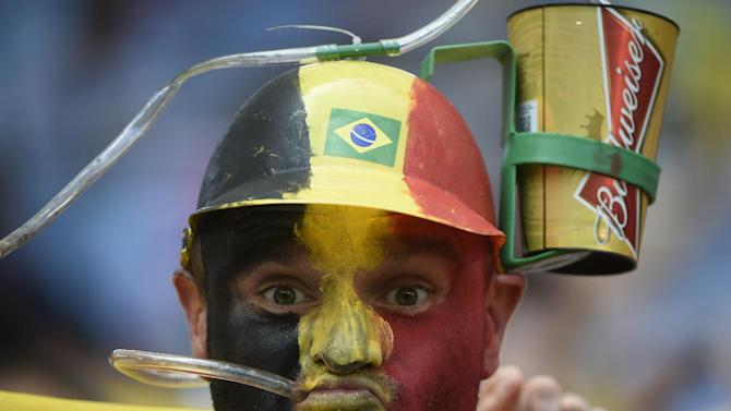 A Belgium fan drinks beer as he waits for the start of a World Cup football match at the Maracana Stadium in Rio de Janeiro on June 22, 2014