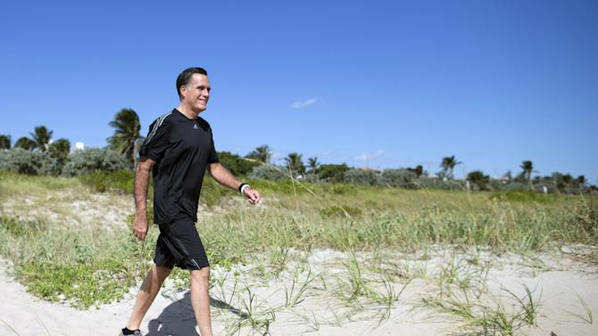Republican presidential candidate, former Massachusetts Gov. Mitt Romney arrives on the beach to watch a flag football game between reporters that cover Romney, and Romney staff on Sunday, Oct. 21, 2012 in Delray Beach, Fla.  Romney took a short break from debate preparations to do the coin toss, and watch the first play of the game. (AP Photo/ Evan Vucci)