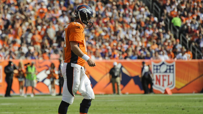 Denver Broncos quarterback Peyton Manning (18) walks off the field in the second quarter of an NFL football game against the Houston Texans, Sunday, Sept. 23, 2012, in Denver. (AP Photo/Jack Dempsey)