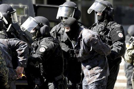 Baltics eye flashpoints with Russia, guard against 'green men'