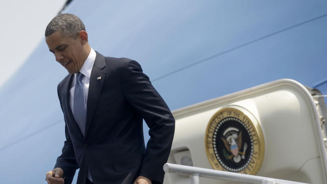 President Barack Obama leaves Air Force One upon his arrival at Benito Juarez International Airport in Mexico City, Thursday, May 2, 2013. Obama is traveling on a three-day trip to Mexico an Costa Rica. (AP Photo/Pablo Martinez Monsivais)