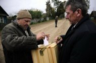 A man casts his ballot in the village of Svidno. Belarus on Monday boasted of a massive turnout in parliamentary polls won by supporters of authoritarian President Alexander Lukashenko but the opposition ridiculed the results as brazenly rigged