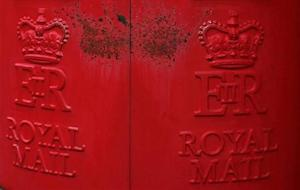 Paint peels on Royal Mail post boxes outside a sorting office in Altrincham, northern England