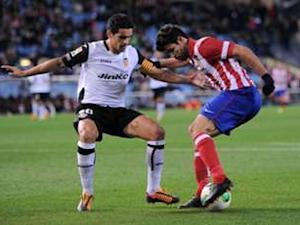 Atletico Madrid 2-0 Valencia (agg 3-1): Godin and Garcia deliver for Simeone's men