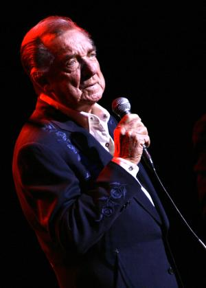 FILE - In this March 10, 2007 file photo, Ray Price performs at the Aladdin Theater for the Performing Arts in Las Vegas. Price, one of country music's most popular and influential singers and bandleaders who had more than 100 hits and was one of the last living connections to Hank Williams, died Monday, Dec. 16, 2013. He was 87. (AP Photo/Laura Rauch, File)