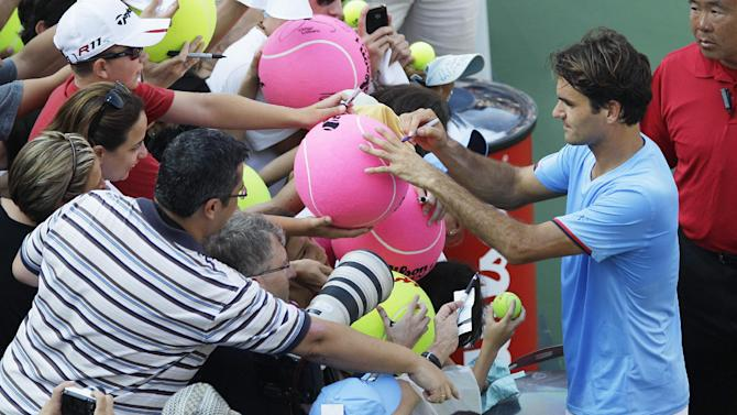 Switzerland's Roger Federer signs autographs after a match with Spain's Fernando Verdasco in the third round of play at the 2012 US Open tennis tournament,  Saturday, Sept. 1, 2012, in New York. Federer saved the lone break point he faced Saturday in a 6-3, 6-4, 6-4 victory over No. 25 Verdasco to advance to the fourth round of the U.S. Open. (AP Photo/Kathy Willens)