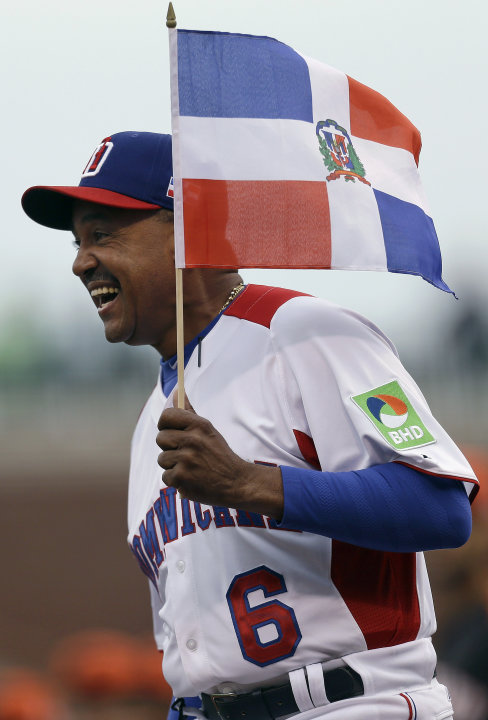 The Dominican Republic's manager Tony Pena smiles as he introduced before a semifinal game of the World Baseball Classic against the Netherlands in San Francisco, Monday, March 18, 2013. (AP Photo/Ben
