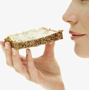 Woman eating toast and ways to eat more and lose weight