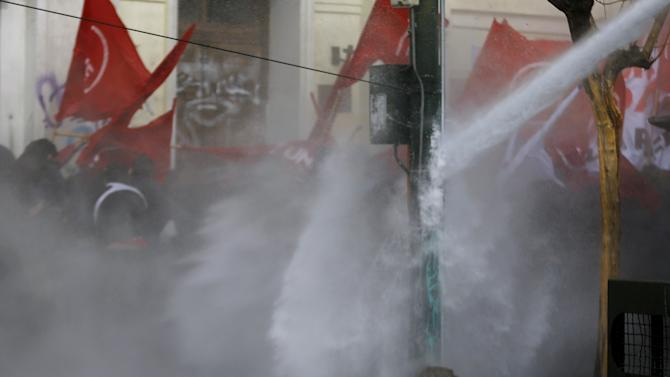 Universidad Catolica de Valparaiso student Rodrigo Aviles Bravo is pictured as police fired water cannons to disperse crowds during a rally