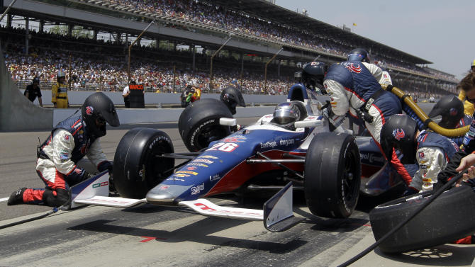 Crew members for Marco Andretti service the car on a pit stop during IndyCar's Indianapolis 500 auto race at Indianapolis Motor Speedway in Indianapolis, Sunday, May 27, 2012. (AP Photo/Darron Cummings)