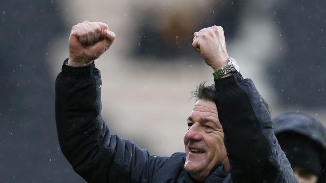 Newcastle United manager John Carver celebrates his team's victory in their English Premier League soccer match against Hull City at the KC Stadium in Hull