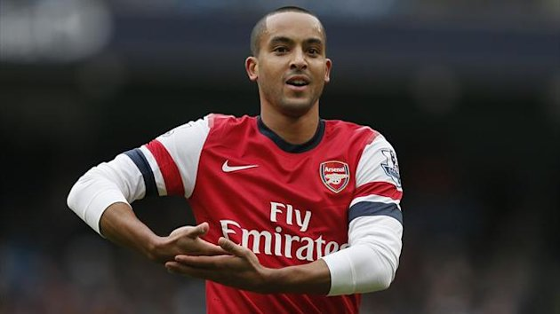 Theo Walcott celebrates scoring for Arsenal against Manchester City (Reuters)