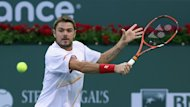 Stanislas Wawrinka of Switzerland returns a backhand to Ivo Karlovic of Croatia during the BNP Paribas Open at Indian Wells Tennis Garden on March 8, 2014