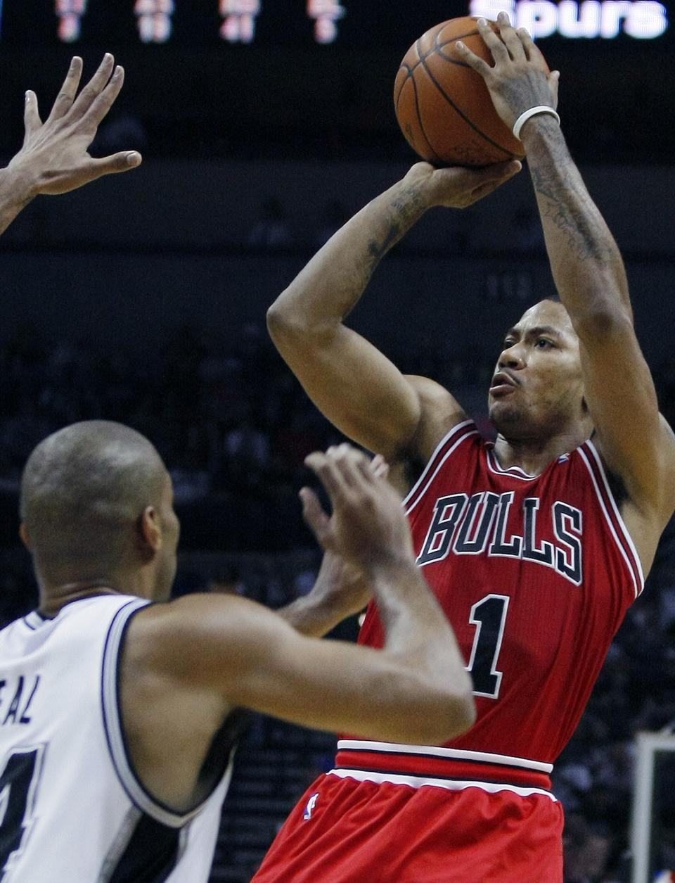 Chicago Bulls' Derrick Rose (1) shoots over San Antonio Spurs' Gary Neal during the second half of an NBA basketball game, Wednesday, Feb. 29, 2012, in San Antonio. Chicago won 96-89. (AP Photo/Darren Abate)