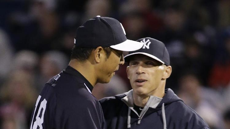 New York Yankees manager Joe Girardi, right, congratulates starting pitcher Hiroki Kuroda after taking the ball from him in the third inning of a spring training baseball game against the Detroit Tigers in Tampa, Fla., Friday, March 7, 2014
