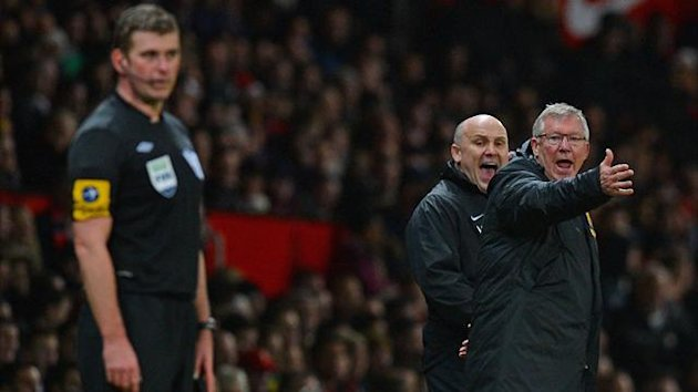 Manchester United's Scottish manager Alex Ferguson (R) and his assistant Mike Phelan (2nd R) gesture to assistant referee Jake Collin (L) during the English Premier League football match between Manchester United and Newcastle United at Old Trafford (AFP)