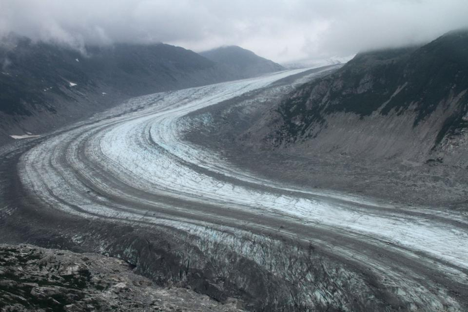 This July 5, 2013 photo shows a glacier in Lake Clark Pass near Port Alsworth, Alaska. Many float planes will fly through the pass as they take day-trippers to Katmai National Park and Preserve to see the brown bears. (AP Photo/Mark Thiessen)