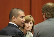 George Zimmerman (L) talks to his attorney Mark O'Mara during his bond hearing in Sanford, Florida, on April 20. Zimmerman, charged with second degree murder over the high-profile shooting of unarmed black teen Trayvon Martin, filed a plea of not guilty on Monday