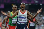 Britain's Mohamed Farah celebrates after winning the men's 5,000m final at the athletics event of the London 2012 Olympic Games on August 11, 2012 in London