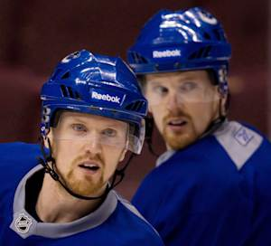 Canucks sign Sedin twins to 4-year extensions