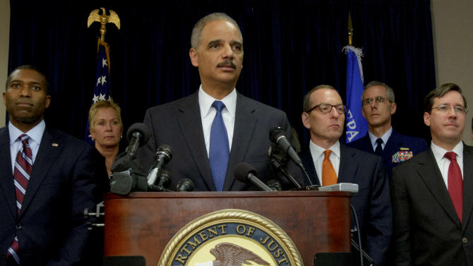 U.S. Attorney General Eric Holder, center, arrives at a press conference followed by Acting Associate Attorney General Tony West, far left, and lead by Assistant Attorney General for the Criminal Division Lanny A. Breuer, top right, to speak about the 2010 Gulf Oil Spill settlement and criminal penalties in New Orleans, La. Thursday, Nov. 15, 2012.  Holder said the settlement and indictments aren't the end of federal authorities' efforts and that the criminal investigation is continuing. Holder says much of the money BP has agreed to pay will be used to restore the environment in the Gulf. (AP Photo/Matthew Hinton)