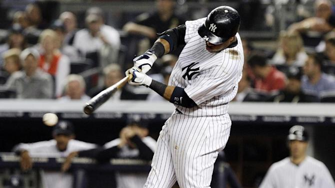 New York Yankees' Robinson Cano hits a two-RBI single during the sixth inning of a baseball game against the Boston Red Sox, Wednesday, Oct. 3, 2012, in New York. Russell Martin and Ichiro Suzuki scored on the hit. (AP Photo/Frank Franklin II)