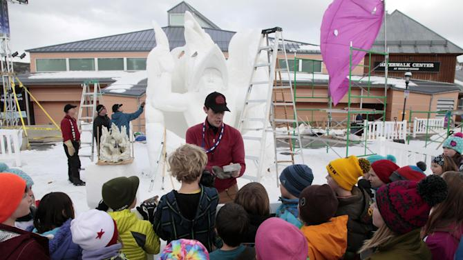 School children listen to Cary Retlin of Team USA Alaska at the 23 annual International Snow Sculpture Championships in Breckenridge, Colo., on Friday, Jan. 25, 2013. Each sculpture started out of a 12 foot tall, 20-ton block of compacted snow at the outdoor art gallery. The sculptures will remain on display through Feb. 3, 2013, weather permitting. Visit www.gobreck.com for more information. (Nathan Bilow / AP Images for the Breckenridge Resort Chamber)
