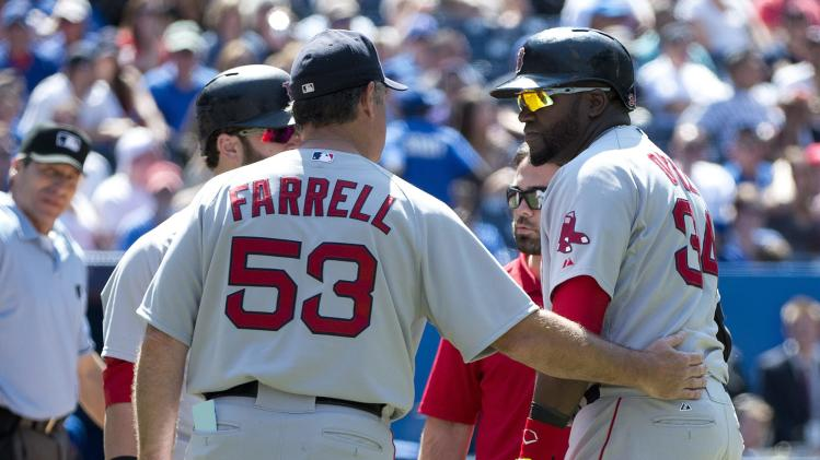 Boston Red Sox manager John Farrell (53) talks with designated hitter David Ortiz, right, after Ortiz was injured in the ninth inning of a baseball game against the Toronto Blue Jays in Toronto, Thursday, July 24, 2014. (AP Photo/The Canadian Press, Nathan Denette)