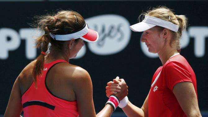 Makarova of Russia shakes hands with Goerges of Germany after winning their women's singles match at the Australian Open 2015 tennis tournament in Melbourne