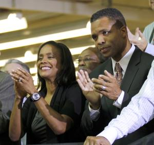 "FILE - In this Aug. 5, 2010 photo, Rep. Jesse Jackson Jr., D-Ill., right, and his wife Chicago Alderman Sandi Jackson, left, applaud as President Barack Obama is introduced at Ford Motor Company Chicago Assembly Plant.  Illinois Rep. Jesse Jackson Jr. says he's a ""public servant"" not a ""perfect servant.""  The Democrat tells The Associated Press that even as he's been dogged by links to disgraced former Gov. Rod Blagojevich and questions about his relationship with a female ""social acquaintance,"" he's never deviated from his mission of bringing jobs to his Chicago area district. (AP Photo/Pablo Martinez Monsivais, File)"