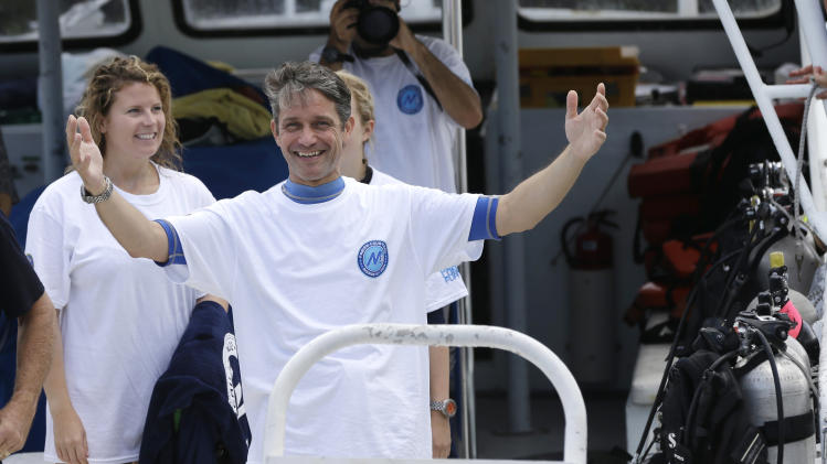 Fabien Cousteau reacts as he returns to the dock after 31 days undersea in the Aquarius Reef Base, Wednesday, July 2, 2014, in Islamorada, in the Florida Keys. Cousteau and his team of filmmakers and scientists dove June 1 to study the effects of climate change and pollution on a nearby coral reef. (AP Photo/Lynne Sladky)
