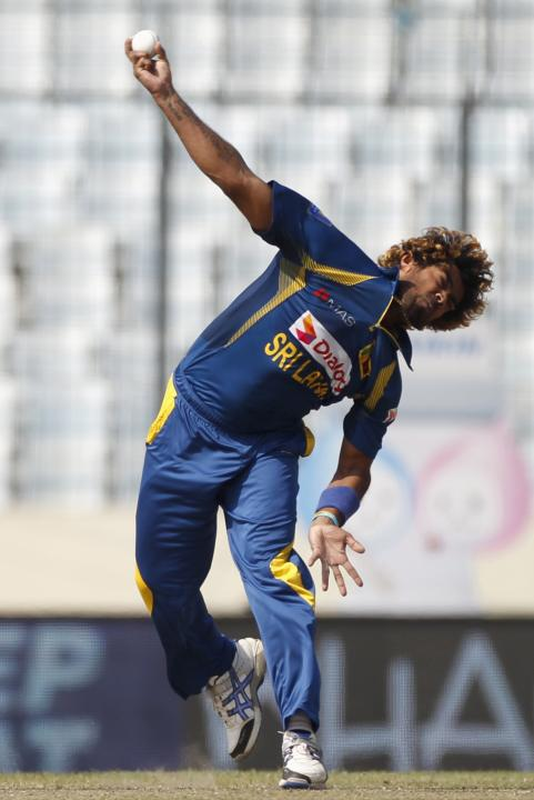 Sri Lanka's Lasith Malinga bowls against Pakistan during their Asia Cup 2014 final match in Dhaka