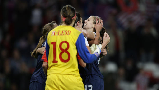 United States' Alex Morgan, right, celebrates with teammates after scoring past Canada's goalkeeper Erin Mcleod (18) during their semifinal women's soccer match at the 2012 London Summer Olympics, Monday, Aug. 6, 2012 at Old Trafford Stadium in Manchester, England. (AP Photo/Jon Super)