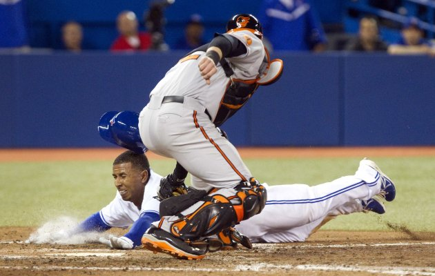 Toronto Blue Jays Anthony Gose is safe at home plate as Baltimore Orioles catcher Mat Wieters misses with the tag in the eighth inning of their American League MLB baseball game in Toronto