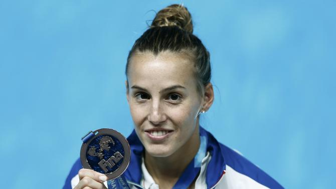 Cagnotto of Italy poses with her bronze medal after women's 3m springboard final at Aquatics World Championships in Kazan