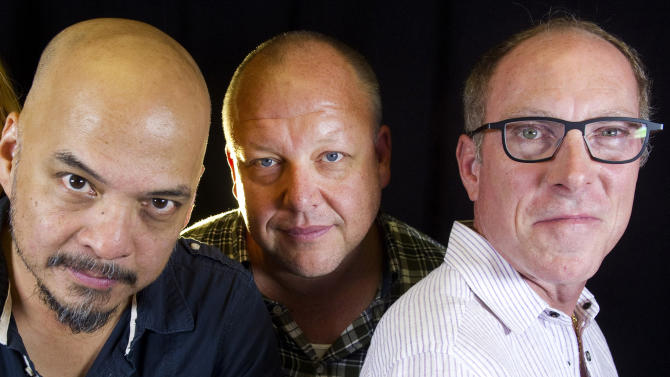 FILE - In this Sept. 20, 2013 file photo, rock band The Pixies, from left, Joey Santiago, Black Francis and David Lovering, pose for a portrait in promotion of their new EP and upcoming tour dates, in New York. They inspired generations of musicians worldwide, served as the blueprint for rock bands, including Nirvana, and got a second life as reunited alternative rock idols. But the Pixies say the best is yet to come. (Photo by Diane Bondareff/Invision/AP)
